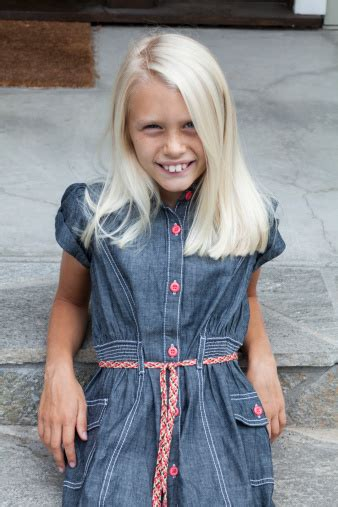 Cute 8 Year Old Blonde Girl Stock Photo - Download Image